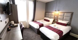 Comfotel Grn - London - Schlafzimmer