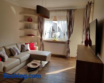 Przytulny Zakatek - Піла - Living room