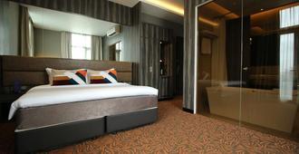 Aqueen Hotel Paya Lebar - Singapur - Schlafzimmer