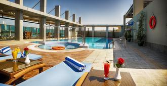 Rose Park Hotel Al Barsha - Dubái - Piscina