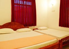 Saffron Guest Inn - Polonnaruwa - Bedroom