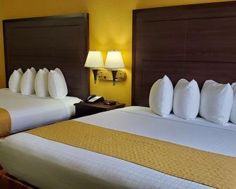 Best Western Executive Inn & Suites - Madisonville - Спальня