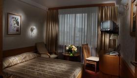 Premier Hotel Rus - Kiova - Makuuhuone