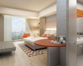Harris Hotel & Conventions Solo - Surakarta City - Bedroom