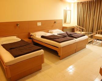 Hotel Ravi Kiran - Alibag - Schlafzimmer