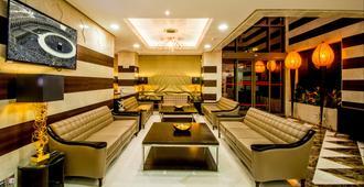 Millennium Al Aqeeq Hotel - Medina - Oleskelutila