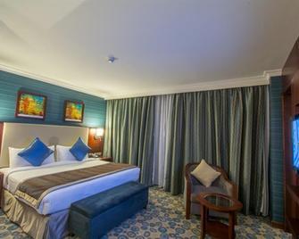 Millennium Al Aqeeq Hotel - Medina - Bedroom