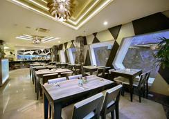 NEO 雷吉安傑蘭迪克酒店 - 雷根 - 庫塔 - 餐廳