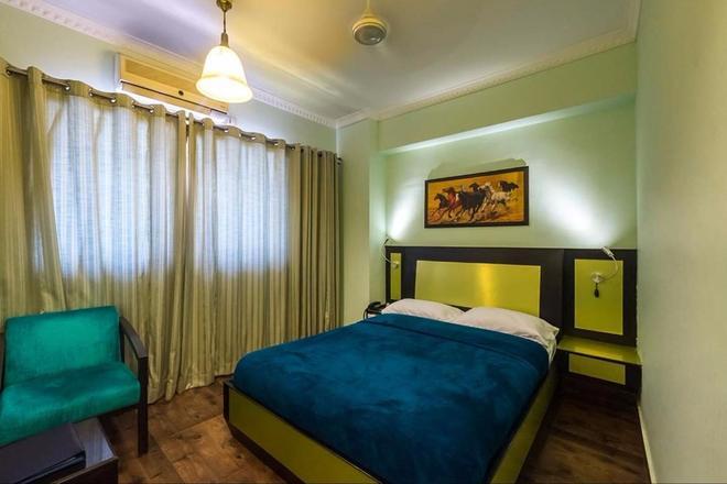 Hotel Komfort Terraces - Bengaluru - Bedroom