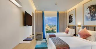 Holiday Inn Bengaluru Racecourse - Bengaluru - Bedroom
