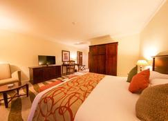 Kigali Serena Hotel - Kigali - Sypialnia