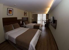 하워드 존슨 라 캐나다 호텔 & 스위트 - 코르도바 - 침실