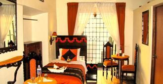 Golden House Inn - Cusco - קוסקו - חדר שינה