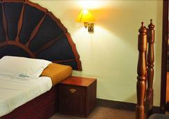 Paulson Park Hotel - Кочин - Спальня