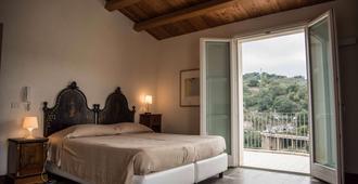Hotel dell'Orologio - רגוזה - חדר שינה