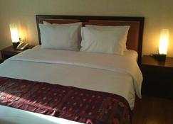 Sutanraja Hotel Convention & Recreation - Manado - Bedroom