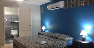 Hostal Villa Catalina - מנגואה - חדר שינה