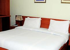 3j's Hotel Ltd - Abuja - Yatak Odası