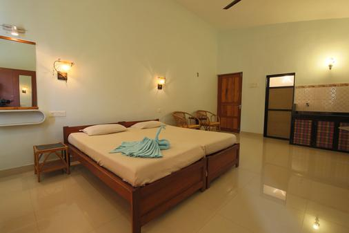 Sea Pearl Guest house - Candolim - Schlafzimmer