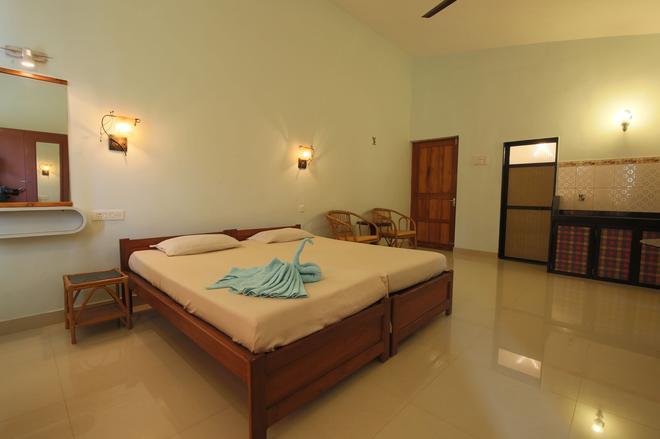Sea Pearl Guest house - Candolim - Makuuhuone