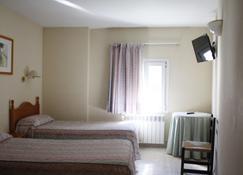 Hotel Joan Canejan - Les - Schlafzimmer