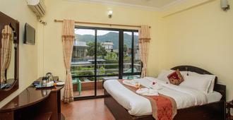 Pokhara Village Resort - פוחארה - חדר שינה