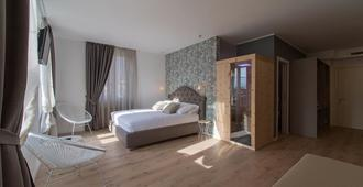 Lainez Rooms & Suites - Trento - Camera da letto