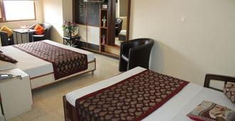 信譽飯店 - 西姆拉 - 臥室