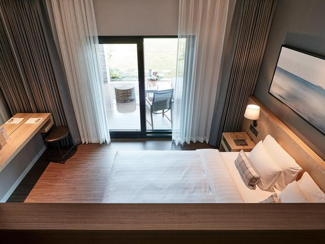The Suites Hotel Jeju - Seogwipo - Makuuhuone