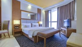 Pearl Park Deluxe Hotel Apartments - Dubai - Phòng ngủ