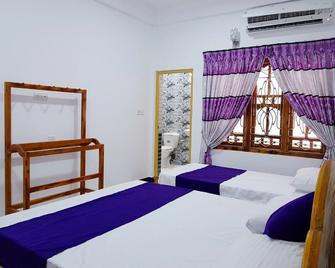 Snp Star Guesthouse - Trincomalee - Schlafzimmer