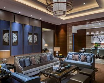 Hualuxe Hotels & Resorts Yangjiang City Center - Yangjiang - Slaapkamer
