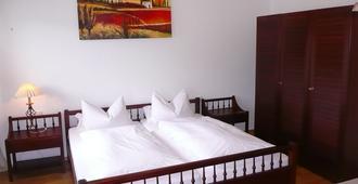 Hotel Schöne Aussicht Garni - Garmisch-Partenkirchen - Bedroom