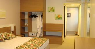 بلو تري بريميام ماناوس - ماناوس - غرفة نوم