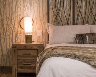 Hôtel Spa Le Suisse - Saint-Donat-de-Montcalm - Bedroom