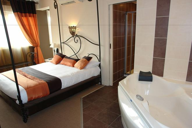 Brit Hotel Olympia - Bourges - Schlafzimmer