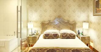 Zhenbao Holiday Hotel Nanjing Yuhua - נאנז'ינג - חדר שינה