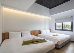 Traveller Inn TieHua Cultural and Creative Hotel - Taitung City - Bedroom
