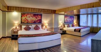 Summit Yashshree Suite & Spa - דאריילינג - חדר שינה