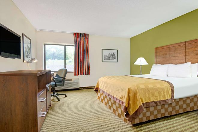 Days Inn & Suites by Wyndham Kansas City South - Kansas City - Makuuhuone