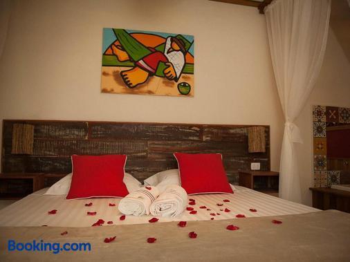 Pousada de Charme Emirados - Ilhabela - Bedroom