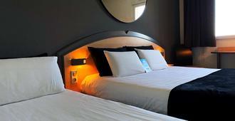Kyriad Brive La Gaillarde Ouest - Brive-la-Gaillarde - Bedroom