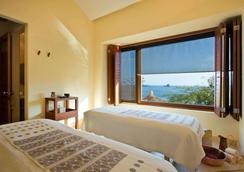 伊斯塔帕嘉佩樂飯店 - 伊斯塔帕 - 臥室