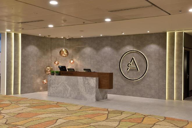 Aerotel Transit Hotel, Terminal 1 - Singapore - Lễ tân