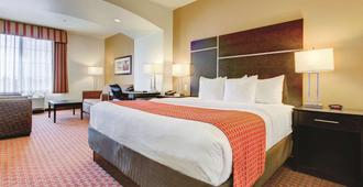 La Quinta Inn & Suites by Wyndham Denver Gateway Park - דנבר - חדר שינה