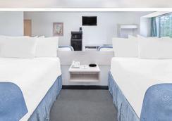 Microtel Inn & Suites by Wyndham Broken Bow - Broken Bow - Habitación