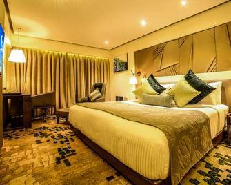 Sayaji Hotel Indore - Indore - Schlafzimmer