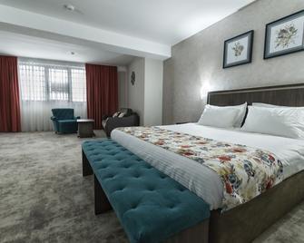 Prestige Boutique Hotel Craiova - Craiova - Slaapkamer