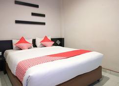 OYO 717 Hotel Dharma Utama Syariah - Pekanbaru - Bedroom