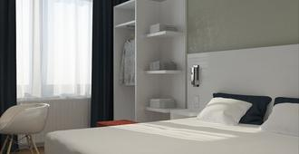 Andante Hotel - האג - חדר שינה